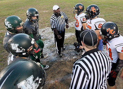 Brad Davis/The Register-Herald Team captains from Wyoming East and Summers County gather at midfield for the opening coin toss Friday night in New Richmond.