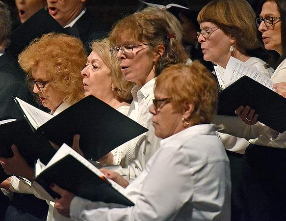 (Brad Davis/The Register-Herald) The Beckley Community Chorus conducts a special performance for a packed house inside the santuary of United Methodist Temple Sunday evening.