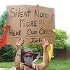 Loria Chasnoff, of Zenith, was one of many  that Protested against racism and police brutality Thursday evening on Washington Street in Lewisburg.<br /> (Rick Barbero/The Register-Herald)