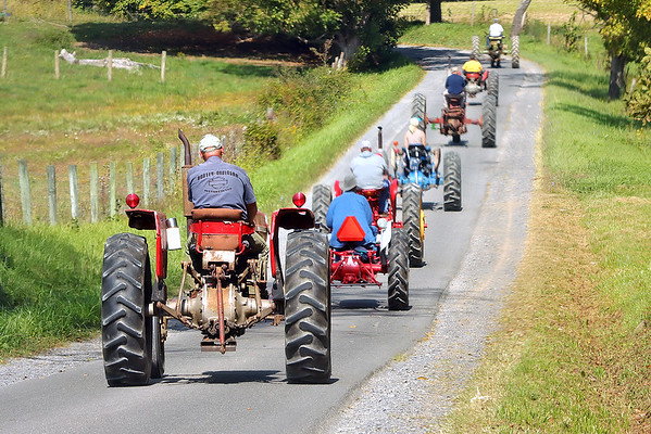 Members of the Tahoe Tractor Club drive down Blue Sulphur Road during the Antique Tractor Ride in the Alderson area Saturday. Jenny Harnish/The Register-Herald