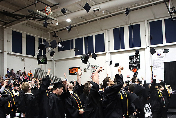 Westside Class of 2021 toss their hats at the end of Saturday's graduation exercise.<br /> Jim Cook for the Register-Herald