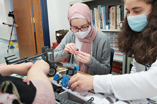 Jasmin Al Yasin, 14, left, and Marian Kisto, 14, both of Charleston, learn how to build a robot at STEM Summer Academy at WVU Tech Thursday. The students had two days of robotics camp with NASA instructors along with days introducing concepts in biology, chemistry and engineering. Jenny Harnish/The Register-Herald