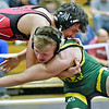 (Brad Davis/The Register-Herald) Oak Hill's Eli Sedlock takes on Greenbrier East's Levi Fisher in a 145-pound weight class matchup during the Coalfield Conference Invitational Friday night in Oak Hill. Oak Hill's Sedlock won the match.