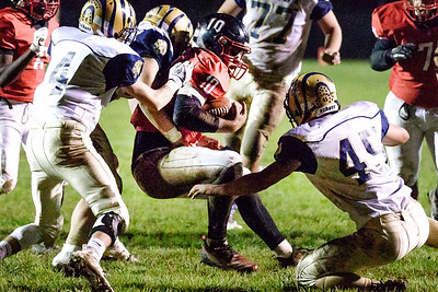 Oak Hill quarterback, Khori Bass is stopped just short of the goal line by Shady Spring defenders: Justin Black (4) and Daylin Toms (45). Chad Foreman for the Register-Herald.