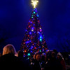 (Brad Davis/The Register-Herald) Spectators gather around as the giant Christmas tree standing at Word Park is illuminated during the city's first tree lighting ceremony Saturday night in Beckley.