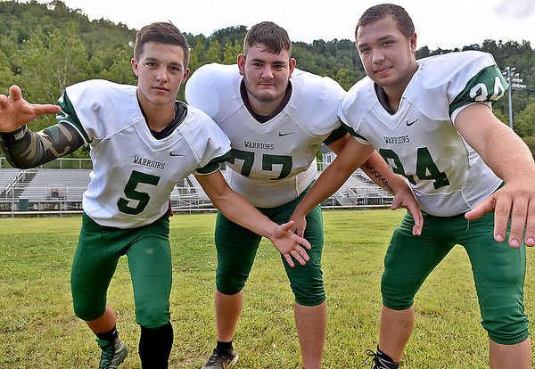 (Brad Davis/The Register-Herald) The Warriors' defensive trio of Joel Cannady (DT), middle, along with Jake Cannady, left, and Zack Raye (LB's) is ready to run down and tackle anything opposing offenses throw at Wyoming East in 2016.