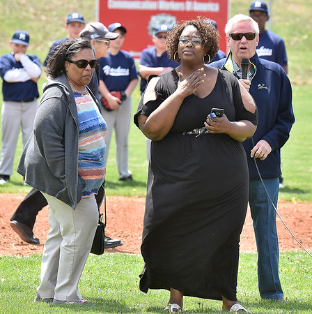(Brad Davis/The Register-Herald) Stephanie Parker, right, holds back tears as she, her son Trey (not photographed) and mother Norma, left, are honored during opening ceremonies at Beckley Little League Park Saturday afternoon.