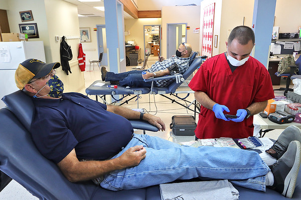 Quinton Walton gets Larry Bunting ready to give blood at a blood drive at the American Red Cross in Beckley Wednesday. A sharp drop in blood donor turnout has contributed to a very low blood inventory level and donors of all blood types are encouraged to donate. Jenny Harnish/The Register-Herald