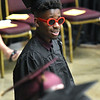 (Brad Davis/The Register-Herald) All smiles and sporting shades, graduate Davis Bockarie looks on towards friends and family in attendance after receiving his certificate in Computer Systems Repair Technology during the Academy of Careers and Technology's 2018 awards and graduation ceremony Thursday evening at the Beckley-Raleigh County Convention Center.