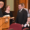 Fayette County circuit court judge Paul Blake, left, prepares to swear in Thomas H. Ewing, third from left, as the new Fayette County judge appointed by Governor Jim Justice, Ewing replaced John W Hatcher Jr. who recently retired. Standing with Ewing is his wife, Lauri, second from left, and children, Seth, Jacob, Ty, and Mindy Ewing.<br /> (Rick Barbero/The Register-Herald)
