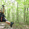 Nedra McDaniel, from Cincinnati, member of the Freelance Council of the Society of American Travel Writers, zips during the TreeTops Zipline Canopy Tours at Adventure On The Gorge Wednesday morning. Forty-one Travel Writers are exploring and writing about West Virginia this week.<br /> (Rick Barbero/The Register-Herald)