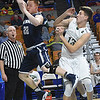 Dustin Brown, of Madonna, left, saves a ball from going out of bounds and launches it over top of Will Fenton. of Fayetteville, during the Class A quarter final game of the Boys State Basketball Tournament held at the Charleston Civic Center Wednesday morning.<br /> (Rick Barbero/The Register-Herald)