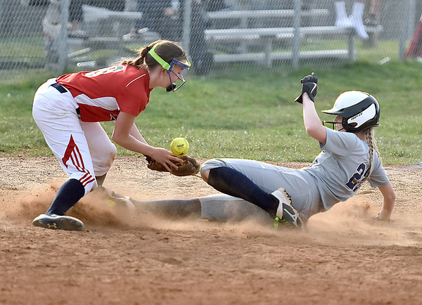 (Brad Davis/The Register-Herald) Shady Spring baserunner Olivia Bowers slides safe into 3rd base as the ball pops out of Independence infiedler Nicole Kester's glove Thursday evening in Shady Spring.