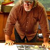 Scot Hill, general manager, looks over an architectural drawning of a possible new home for Theatre West Virginia.<br /> (Tina Laney/For The Register-Herald)