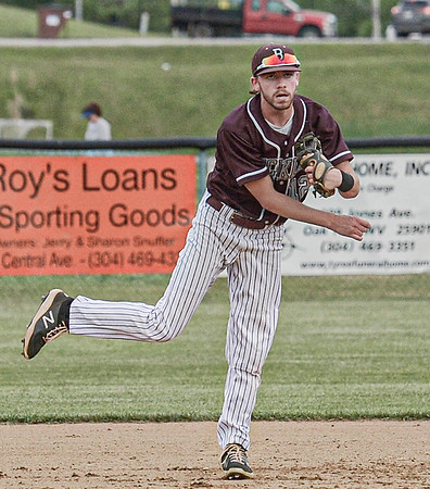 F. Brian Ferguson/Register-Herald  Woodrow Wilson shortstop Cooper Vaught makes the throw to first for the out against Oak Hill during Tuesday action in Oak Hill.