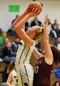 Wyoming East's Emily Saunders puts up a basket over Woodrow Wilson's (30) during their basketball game Wednesday in New Richmond. (Chris Jackson/The Register-Herald)