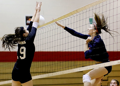 Chris Jackson/The Register-Herald Liberty's Hannah Trump (29) attempts to block a strike by Independence's Mykal Daniel (16) during their match at Independence High School.