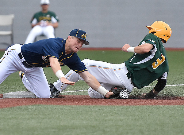 (Brad Davis/The Register-Herald) West Virginia's Taylor Hillson is forced out by Lafayette third baseman Eric Willis after reaching to pick a low throw from the turf during the Miners' loss to the Aviators Sunday evening at Linda K. Epling Stadium.