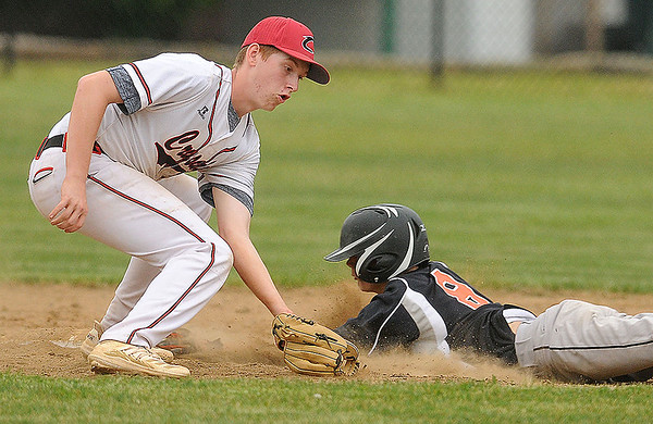 Ben Lane of Summers county, slides in ahead of the tag applied by Greater Beckley's Eli Grubb. Jon C. Hancock/for The Register-Herald