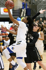 (Brad Davis/The Register-Herald) WVU Tech's Zjhane West drives to the basket and scores past Point Park defender Nikki Corcoran Saturday night at the Beckley-Raleigh County Convention Center.