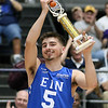 (Brad Davis/The Register-Herald) WVU commit Jordan McCabe receives the trophy for winning the Scott Brown Classic three-point competition Saturday night at the Beckley-Raleigh County Convention Center.