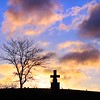 The sun rises over a cross at the Greenbrier Mausoleum cemetary in Lewisburg Friday. <br /> Jenny Harnish/for the Register-Herald