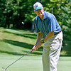 (Brad Davis/The Register-Herald) Jim Hamrick watches his putt during BNI action Sunday afternoon at Glade Springs' Stonehaven Golf Course.