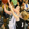 (Brad Davis/The Register-Herald) Wyoming East's Kaytlin Daniels drives to the basket as Westside's Taylor Brown defends Thursday night in New Richmond.