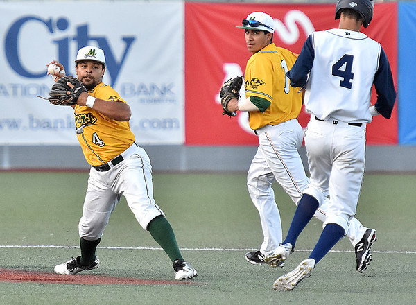 (Brad Davis/The Register-Herald) Butler baserunner Daniel Patrice, far right, turns out of the basepath rather than slide to break up the play as Miners shortstop DePaul Blunt, left, turns a double play off the bat of Blue Sox hitter Chris Law Wednesday night at Linda K. Epling Stadium.