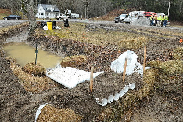Rick Barbero/The Register-Herald Crews dammed a creek Monday morning because of a diesel spill in Alvin off of Route 92.