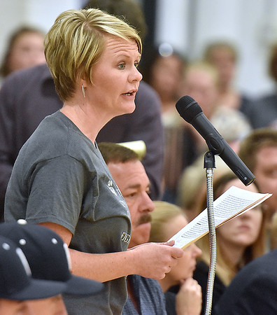 (Brad Davis/The Register-Herald) Amy Bennett speaks in opposition during a public hearing on the possible closing of Valley High School Thursday evening in Smithers.