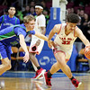 Oak Hill's Darrick McDowell (32) steals the ball from Robert C. Byrd's Logan Parsons (23) during their West Virginia State Championship Class AA Quarter Finals in Charleston on Thursday. (Chris Jackson/The Register-Herald)