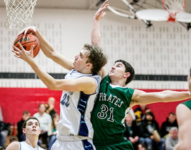 Chris Jackson/The Register-Herald Valley's (22) grabs a rebound over Fayetteville's (31) during the second half of their basketball sectional Wednesday in Oak Hill.