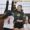 (Brad Davis/The Register-Herald) Greenbrier East's Karlei Shaver rips a spike as St. Albans' Kennedy D'Antoni leaps to block it during the Class AAA Regional Volleyball tournament Saturday afternoon in Beckley.