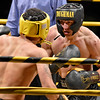 (Brad Davis/The Register-Herald) Defending champ Michael Suttle, right, takes on Antonio Weakley during the Original Toughman Contest Friday night at the Beckley-Raleigh County Convention Center. Suttle would win the fight.