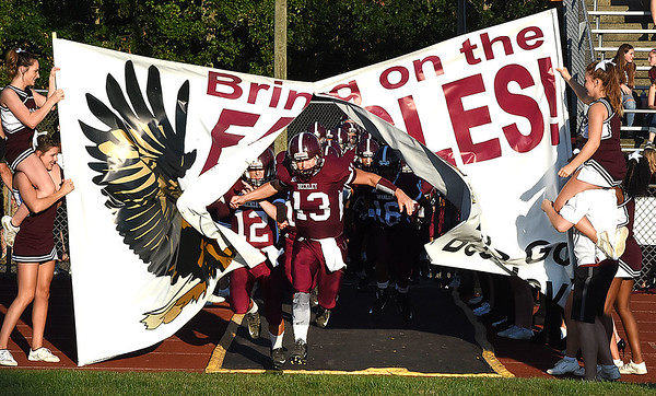 Noah Norman, of Woodrow Wilson, breaks through the Fling Eagles banner for game against Riverside High School at Van Meter Stadium in Beckley Friday night. (Rick Barbero/The Register-Herald)