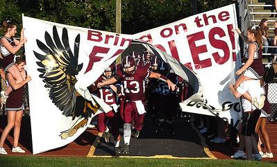 Noah Norman, of Woodrow Wilson, breaks through the Fling Eagles banner for game against Riverside High School at Van Meter Stadium in Beckley Friday night. (Rick Barbero/The Register-Herald)