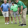 Marshall assistant football coach Mike Bartrum, reacts after just missing an eagle putt on the par 5, 4th hole at Grandview Country Club during the Marshall University Southern Coalfields Alumni & Big Green Club 31st annual golf outing. Watching the putt from left, Jeff McGraw, Davey Jude and Artie Jenkins.<br /> (Rick Barbero/The Register-Herald)