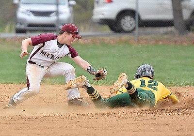 (Brad Davis/The Register-Herald) Greenbrier East baserunner Bailee Coles steals 2nd base as he dodges Woodrow Wilson 2nd baseman Hunter Tolliver's tag Wednesday evening in Beckley.