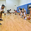 (Brad Davis/The Register-Herald) Young basketball players from around the area work on their ball handling skills as they run through drills with former West Virginia Mountaineers player John Flowers, far left, (2007-2011) during the Fundamentals with coach Herbie Brooks basketball camp Saturday afternoon at Beckley-Stratton Middle School. Flowers has been playing professionally in Europe since his Mountaineer days, spending last season with Champagne Chålons-Reims of the LNB Pro A League in France.