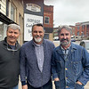 Mt. Hope mayor Michael Kessinger, center poses with, Robbie Wolfe, left and his brother, Mike Wolfe, telvision reality stars on American Pickers. They visited the Bon-Bon store on Main Street in Mt. Hope Monday.<br /> Submitted Photo by Michael Kessinger