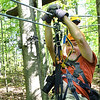 David Swanson, of San Diego, member of the Freelance Council of the Society of American Travel Writers, zipping during the TreeTops Zipline Canopy Tours at Adventure On The Gorge Wednesday morning. Forty-one Travel Writers are exploring and writing about West Virginia this week.<br /> (Rick Barbero/The Register-Herald)