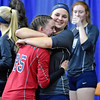 (Brad Davis/The Register-Herald) Indy seniors Ashleigh Sexton, right, and Nicole Kester share a big hug after defeating Oak Glen to advance in the State Volleyball Tournament Friday morning at the Charleston Civic Center.