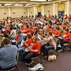 (Brad Davis/The Register-Herald) A huge turnout of public employees mull over their information packets during a PEIA public hearing Wednesday night at Tamarack.