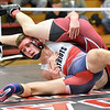 (Brad Davis/The Register-Herald) Independence's Trey Hart takes on Oak Hill's William Spearen in a 152-pound weight class matchup during the Coalfield Conference Invitational Friday night in Oak Hill. Indy's Hart won the match.