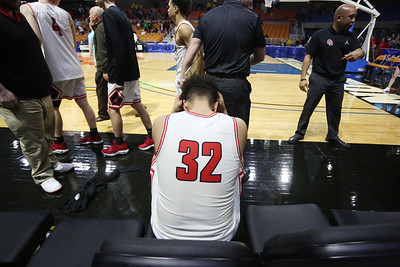 Oak Hill's Darrick McDowell hangs his head after their West Virginia State Championship Class AA Quarter Finals loss to Robert C. Byrd in Charleston on Thursday. (Chris Jackson/The Register-Herald)