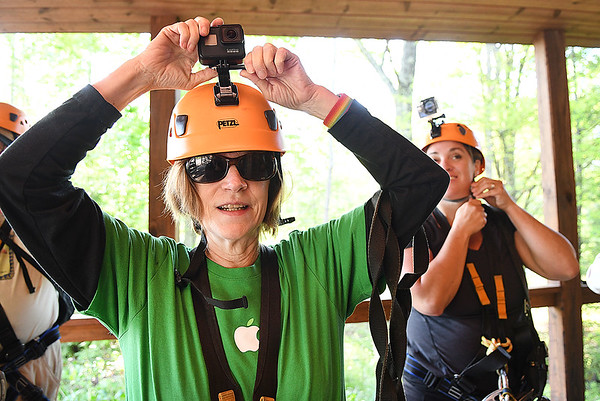 Terry Gardner, from California, member of the Freelance Council of the Society of American Travel Writers, prepares to go on a the TreeTops Zipline Canopy Tours at Adventure On The Gorge Wednesday morning. Forty-one Travel Writers are exploring and writing about West Virginia this week.<br /> (Rick Barbero/The Register-Herald)