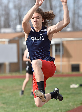 (Brad Davis/The Register-Herald) Independence's Cody Godbey competes in the long jump during the Dickey's Invitational Friday afternoon at Independence High School.