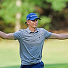 Landon Perry gestures to spectators after finishing the No. 18 hole at The Cobb during the championship round of the annual BNI Tournament Monday at The Resort at Glade Springs. Perry won the tournament. (Chris Jackson/The Register-Herald)