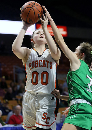 (Brad Davis/The Register-Herald) Summers County's Erica Merrill drives to the basket during the Lady Bobcats' opening round State Tournament win over Charleston Catholic Wednesday evening at the Charleston Civic Center.
